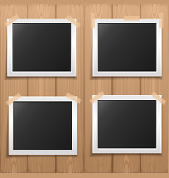 set photo frame placed on a wooden background vector image