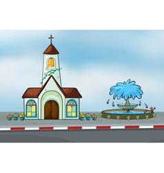 A church and a fountain vector image vector image
