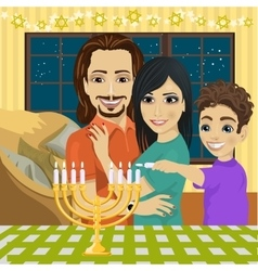 Happy family lighting Hanukkah menorah vector