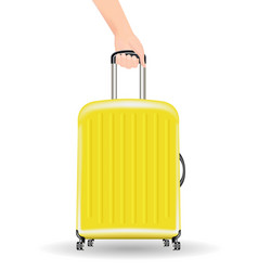 real yellow wheeled travel bag with hand vector image