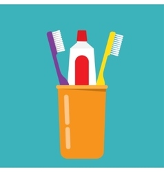 Toothbrush toothpaste in a glass vector