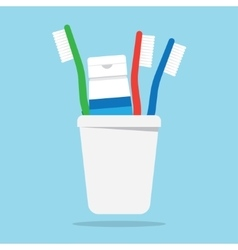 Three toothbrushes and toothpaste in a glass vector image