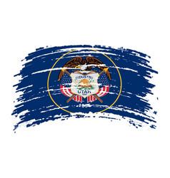 Utah flag in grunge brush stroke vector