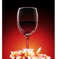 A glass of wine with flowers vector