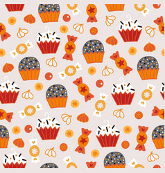 halloween seamless pattern with candies cupcakes vector image