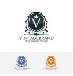 shield logo with letter v vector image
