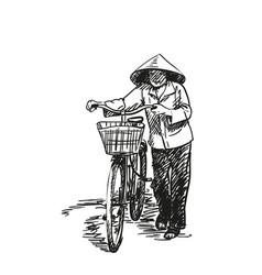 Woman in vietnamese conical hat walking vector