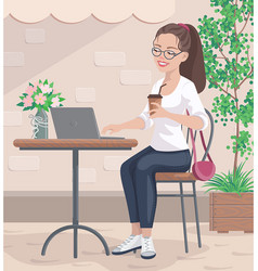 Smiling girl in glasses sits in street cafe vector