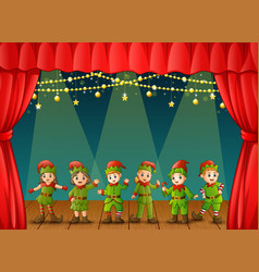 christmas elves performing on stage vector image