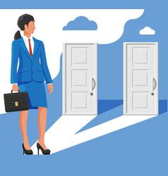businesswoman standing in front two doors vector image