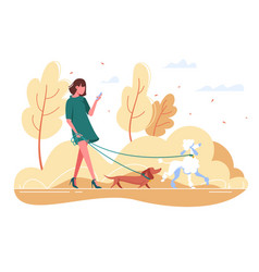 young woman walks with dog through woods vector image