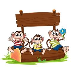 Three monkeys under the empty signboard vector image vector image