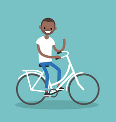 Young black man riding a bike and waving his hand vector