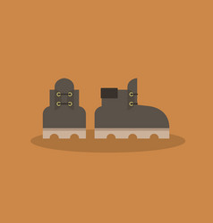 A pair of leather brown boots icon flat vector