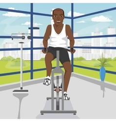 african american man doing exercise on bike at gym vector image