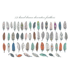 set of hand-drawn decorative feathers vector image