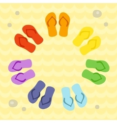 Rainbow flip flops in circle on the sand vector