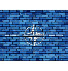 Flag of NATO on a brick wall vector image vector image