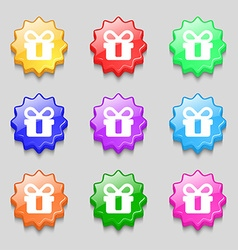 gift icon sign symbol on nine wavy colourful vector image