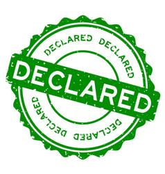 Grunge green declared word round rubber seal vector