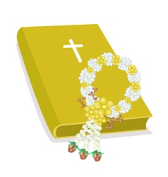 Holy Bible with Wooden Cross and Flower Garland vector image