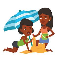 friends building sandcastle on beach vector image vector image