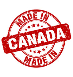 made in canada red grunge round stamp vector image