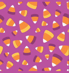 scattered candy corn seamless pattern vector image
