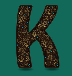 Letter k with golden floral decor vector