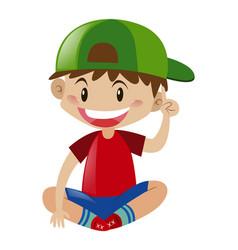 Boy in red shirt sitting vector