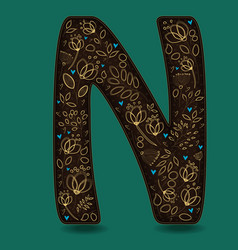 Letter n with golden floral decor vector