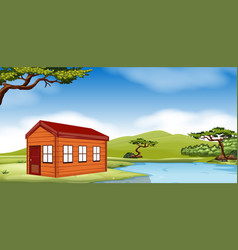 wooden cottage by the pond vector image