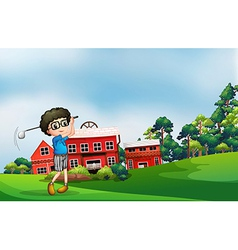 A boy playing golf near the barn vector image vector image