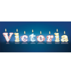 VICTORIA written with burning candles vector