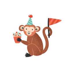 funny monkey in cone hat holding festive cupcake vector image