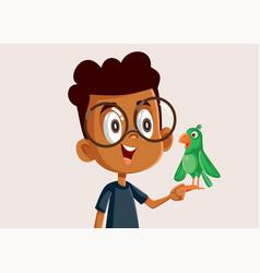 African boy holding a little parrot vector