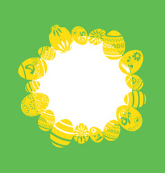 Yellow decorative eggs as easter frame on green vector