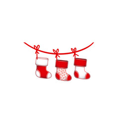 Ornament boots christmas holding in red rope vector