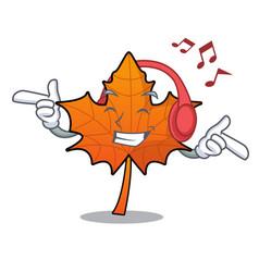 Listening music red maple leaf mascot cartoon vector