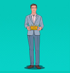 Pop art man holding golden crown firts place prize vector
