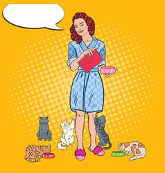 pop art beautiful woman feeding her cats pet care vector image