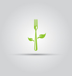 vegetarian food fork with leafs isolated icon vector image