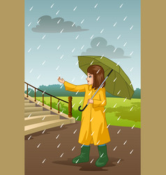 girl carrying umbrella under the rain vector image