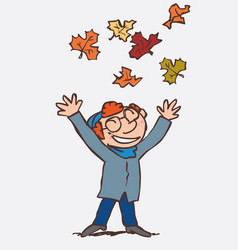 red hair child throwing in the air funny autumn vector image
