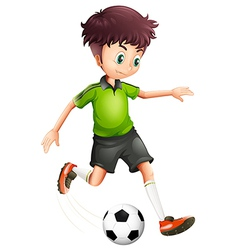 A boy with a green shirt playing soccer vector image