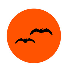 Two black bats on an orange circle round vector