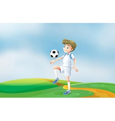 A soccer player practicing vector image