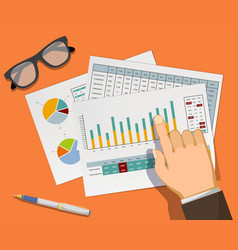Man pointing at graphs and charts in the document vector