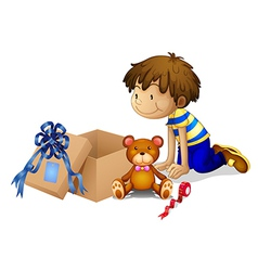 A boy looking at the box vector image