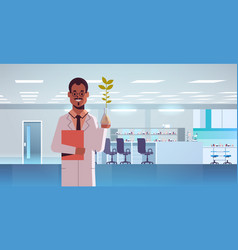 male scientist examining plant sample in test tube vector image